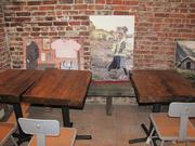 Part of the United By Blue space includes cafe tables and pictures of waterway clean-ups organized by the company.