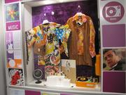 "A display shows the psychedelic shirts of 1968, another fringe jacket and John and Yoko's ""Two Virgins"" album cover. At right is Johnny Cash's live ""At Folsom Prison"" album."