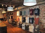 Another view of the store. Overhead lighting fixtures are made from galvanized-steel tubs.