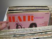 "A bin of vinyl albums from 1968 includes the soundtrack from the musical ""Hair."""