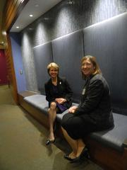 Christine Holt (right), Hold Redeemer's chief experience officer, and Marian Thallner, the health system's senior vice president and chief administrative officer, on the bench built into a boulevard wall.