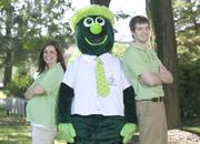 """3rd Federal Bank — When 3rd Federal Bank wanted to reinvent its mascot, it staged a mock disappearance of its mascot during a public parade to launch the """"Where's 3rd Fred"""" campaign. The campaign followed 3rd Fred's travels around the world through YouTube videos and Facebook and Twitter updates and announced its reappearance as a transformed mascot. (Pictured left to right: Carolyn Maniscalco, assistant marketing manager; 3rd Fred; Andrew Ortwein, marketing specialist, 3rd Fed Bank.)"""