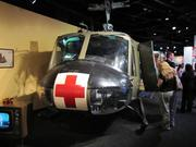 "An actual ""Huey"" helicopter used in the Vietnam War is part of the exhibit. At lower left, a television plays newsreels of Walter Chronkite broadcasts."