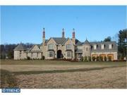 """No. 28 - 5971 Upper York Road, Solebury. ZIP: 18938. Price: $2,495,000. Distinguishing features: """"Built of castle-cut stone and old-world limestone plaster on over nine privately situated acres."""""""