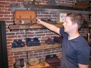 United By Blue founder Brian Linton shows a messenger bag, which sells for $88.