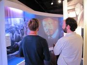 The exhibit features film clips of Martin Luther King Jr. and a program from his funeral.
