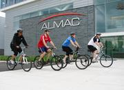 Almac — Almac encourages physical activity by offering Yoga and Zumba classes after work hours. Additionally, these employees formed a cycling group that meets periodically to cycle at lunchtime.