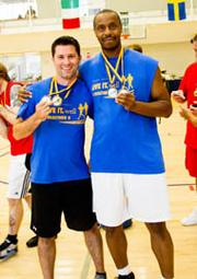 "Drexel University — A couple of athletes display their medals from the university's ""employee olympics."""