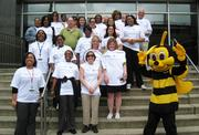 Educational Commission for Foreign Medical Graduates — Employees gather for a picture with Buzz the Bee, the company's Bee Healthy Mascot, to celebrate their National Walk at Lunch.