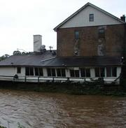 The Old Mill Inn in Hatboro, Pa. Believed to be the oldest building in Hatboro, the inn closed earlier this year after a separate flood. Hurricane Irene added to the damages. The building, which is for sale, sits next to the Pennypack Creek.