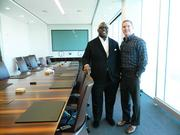 Osagie Imasogie (left), Iroko's chairman, and John Vavricka, president and CEO, in the company's new boardroom.