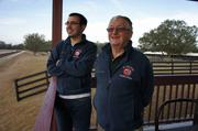 Justin Nicholson and Ninety North trainer Jimmy Toner watch their 2-year-olds prep for training in Ocala, Fla.
