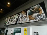 Photographs featuring great Eagles players, by position, have replaced what was gray space on the walls along the stadium's main concourse.