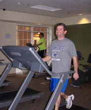 Riddle Village — Two Riddle Village employees break a sweat at the company fitness center, which is free of charge to staff members.