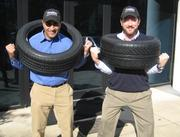 """TireVan, with Splash Media — TireVan, a mobile tire installation business, created a """"12 Days of Christmas"""" contest for the holidays that gave away tires and other gifts to the communities it serves.  (Pictured left to right: Taran Sodhi, corporate development manager, and Phil Pifer, president and CEO, TireVan. Not pictured: Mouyyad Abdulhadi, social media manager, Splash Media.)"""