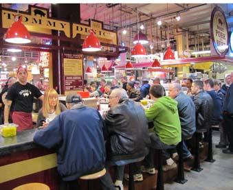 Hungry customers crowd around Tommy DiNic's at the Reading Terminal Market in Philadelphia.