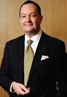 Auxilium CEO Adrian Adams