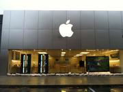 Sandbags guard the Apple store at Suburban Square in Ardmore.