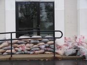Sandbags out front of vacant space at the Fort Washington Office Center near the Pennsylvania Turnpike exit. The site is prone to flooding.