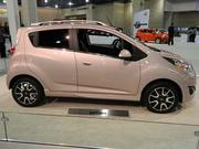 What we have here is a pink Chevrolet Spark. The Spark will hit dealerships this summer.