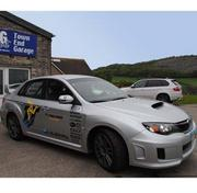 Rally driver Mark Higgins drove this Subaru WRX STI on several timed laps of the famous Isle of Man TT motorcycle course.