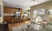 The kitchen and living room in the 2400 South Darien model.