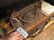 A United By Blue canvas-and-leather bag is modeled after an old-school tool bag.
