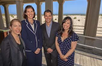 Teaming up to promote the city: Christine Spencer (from left), Liza Cartmell, Jeff Guaracino and Judi Ludovico by the Boardwalk in Atlantic City.