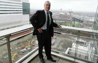 CHOP CEO Dr. Steven Altschuler stands high above the excavation project.