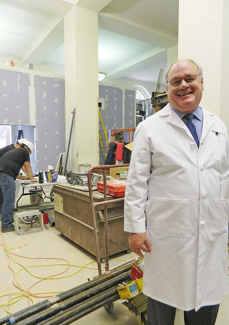 Dr. Robert E. Booth Jr. has a good time inspecting 3B Orthopaedics' new digs.