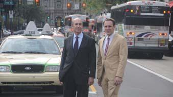 Barry Seymour (left) and Christopher Puchalsky on Market Street during afternoon rush hour.