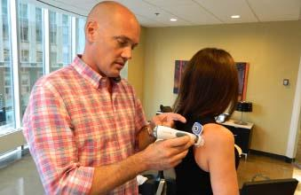 Dr. Patrick Mooney demonstrates Prelude and Symphony products on Echo's Director of Corporate Communications Christine H. Olimpio.
