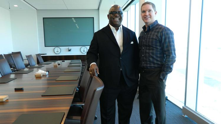 Osagie Imasogie (left), Iroko's chairman, and John Vavricka, CEO, in the boardroom at the company's new headquarters at the Philadelphia Navy Yard Corporate Center.
