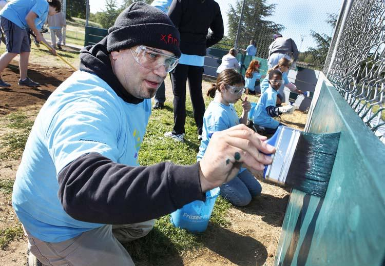 Volunteers pitched in at a Comcast Cares Day project site in 2011.