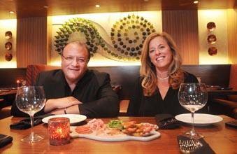 Husband-and-wife team Jan Talamo and Linda Rosanio in the dining room at Catelli Duo.