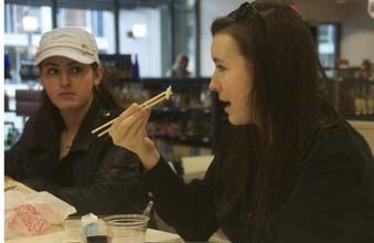 Drexel sophomores Alexandria Rudisill (right) and Jillian Maggio enjoy some conversation and food at the Market 16 & Noodle Bar.