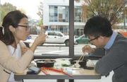 Yang Meng (left) and Long Jin, both Drexel University freshmen from China, have lunch at the Market 16 & Noodle Bar on Market Street.