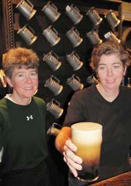 Meg and Anne McNally serve up a pint.