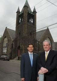 Jay Goldstein (left) and Robert Marino, in front of a project they're financing, the conversion of a church at 308 Monastery Ave. in Manayunk into apartments.