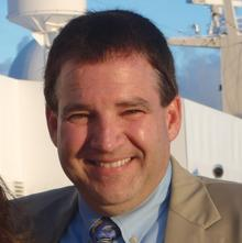 JOHN F. COLGAN