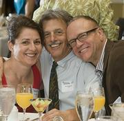Health Care Heroes winner Dr. Earl Weisbrod (center) is flanked by his wife Maria and colleagueKris Volcheck.