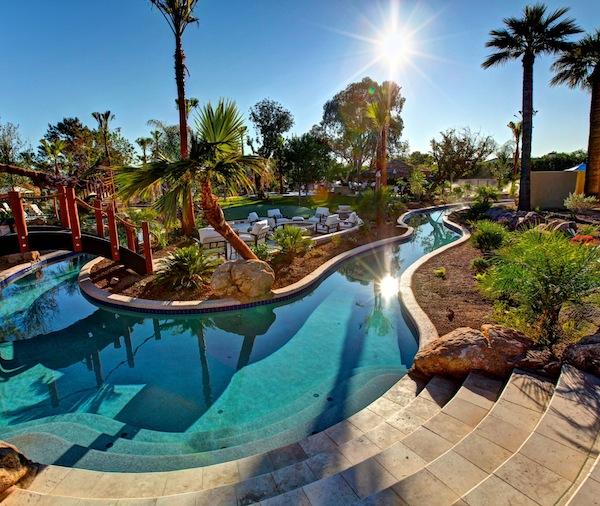 A Lazy River Pool Winds Through The Estate