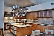 The main housekitchen features a large island and gourmet appliances.