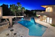 The swimming pool and back yard of Kurt Warner's home that is heading to auction.