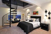 The Kurt Warner home features a bedroom with a spiral staircase.