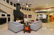 The living room complete with built-in fireplace at Kurt Warner's Paradise Valley home.