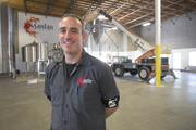 """Proud SanTan owner and head brewer Anthony Canecchia shares the story of the brewery's growth, playing coy about out-of-state expansion. Behind him is the 50-barrel brewing system. As the old saying goes: """"Where the magic happens."""" Or, at least, begins."""