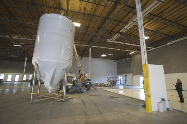 The brewing tanks at San Tan Brewing in Chandler are put in place during the company's recent facility upgrade. The company is planning to expand its reach into the Southwest with the new facility.