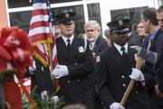 Glendale Mayor-elect Jerry Weiers stands for the Glendale Fire Department Honor Guard pass.