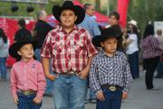 Garrett Lopez, left, age 4, and his brothers Hunter, 9, and Cody, 6 were with their parents from Queen Creek at US Airways Center Feb. 4, enjoying the pre-concert festivities outside the arena.